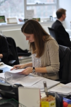 Sarah, our production manager, checking proofs in the office