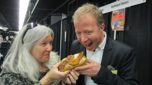 Maggie Hawkins and Tommi enjoying the Bacon Maple Doughnut