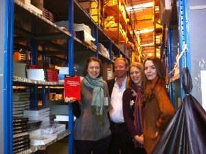 Laura, Tommi, Elinor and Flo with one of our books in the warehouse