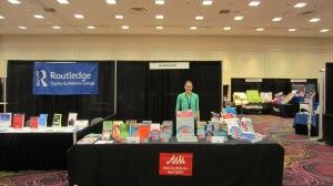 Laura at the NABE book stand