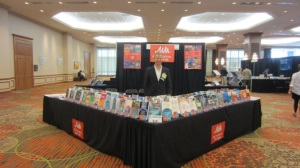 Tommi with our beautiful display of books at a conference