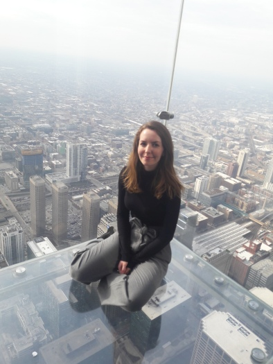 "Sitting on ""The Ledge"", 103 floors up"