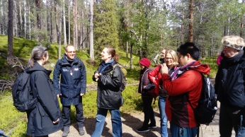 Delegates enjoying the forest - including CVP authors Johan Edelheim and Heike Schänzel